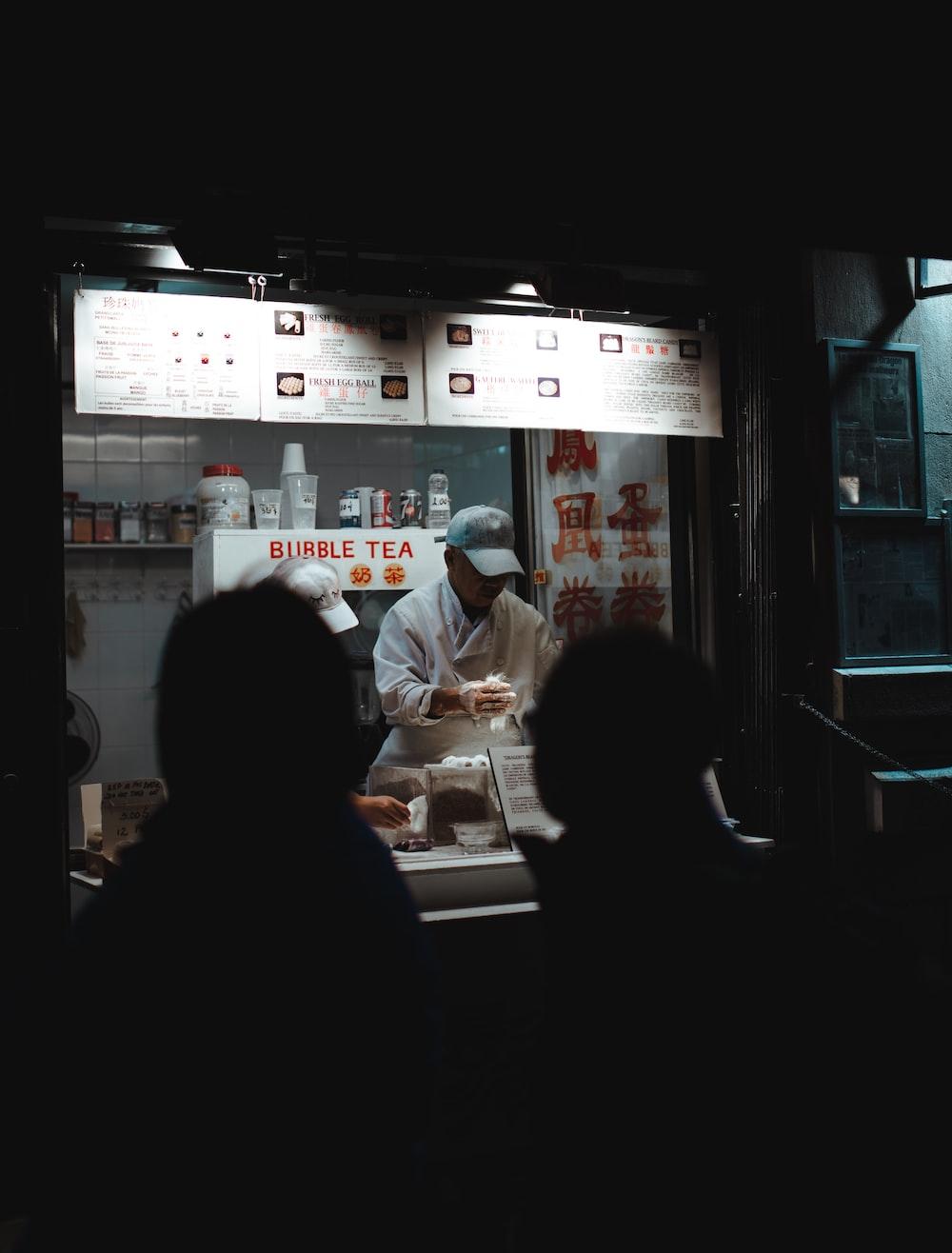 man on food stall