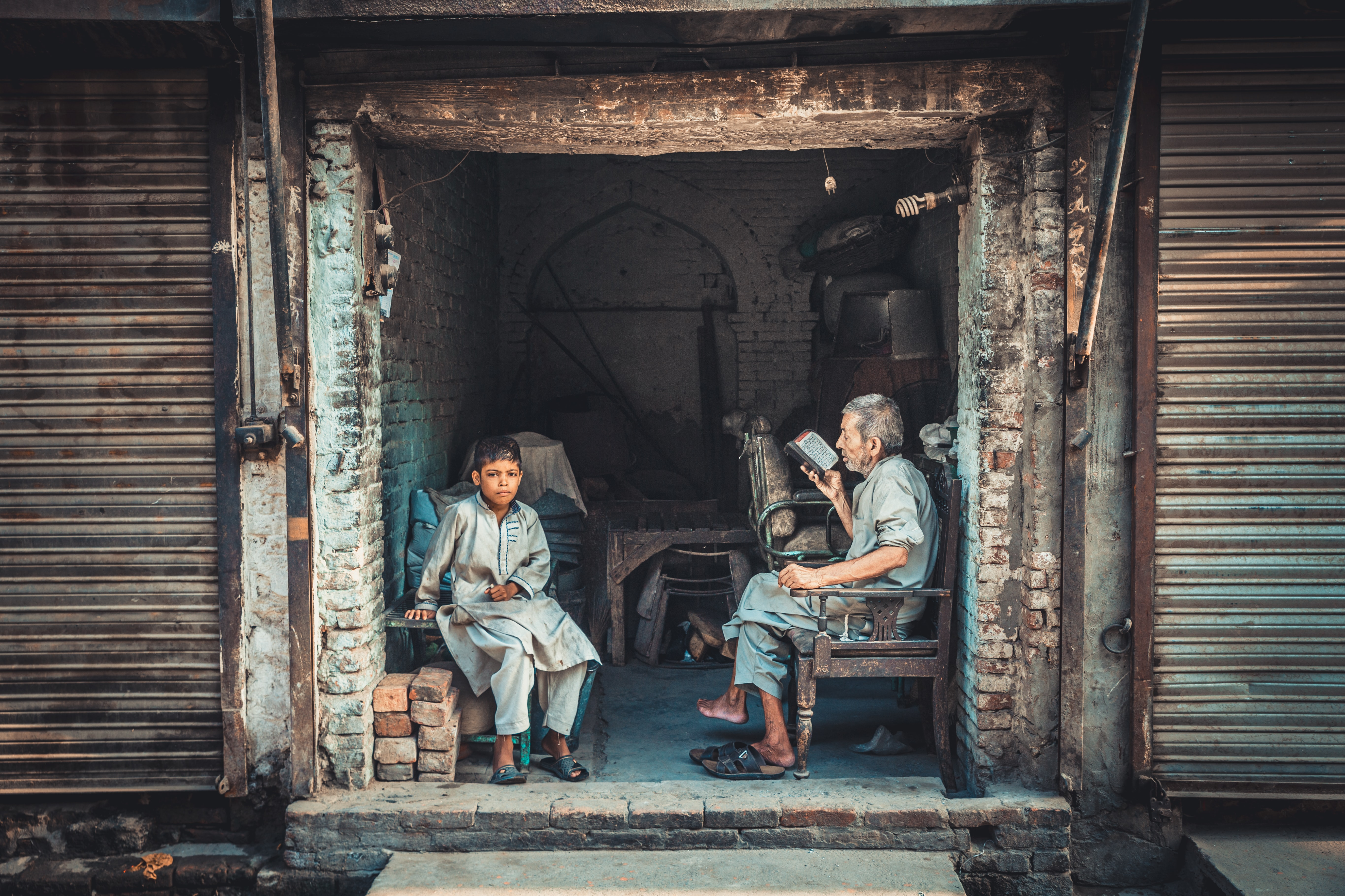 old man and boy sitting on chair