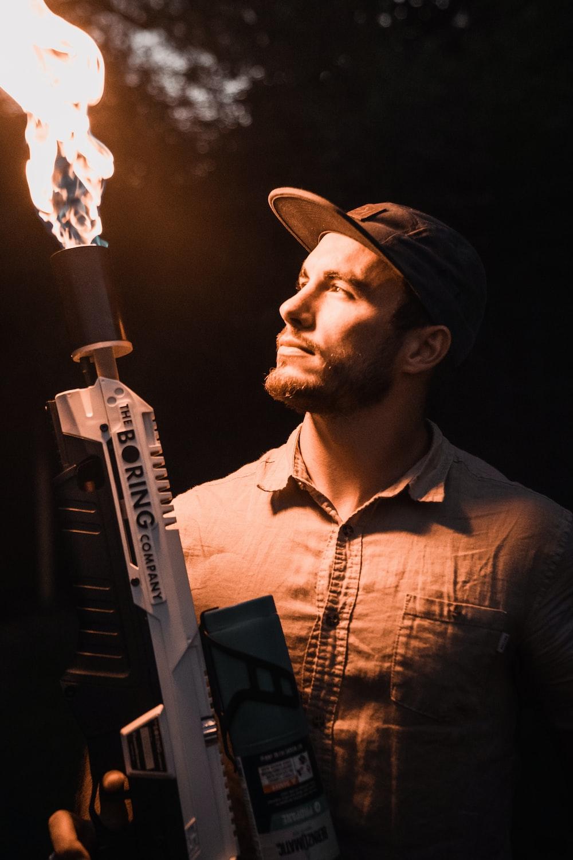 man holding flamethrower