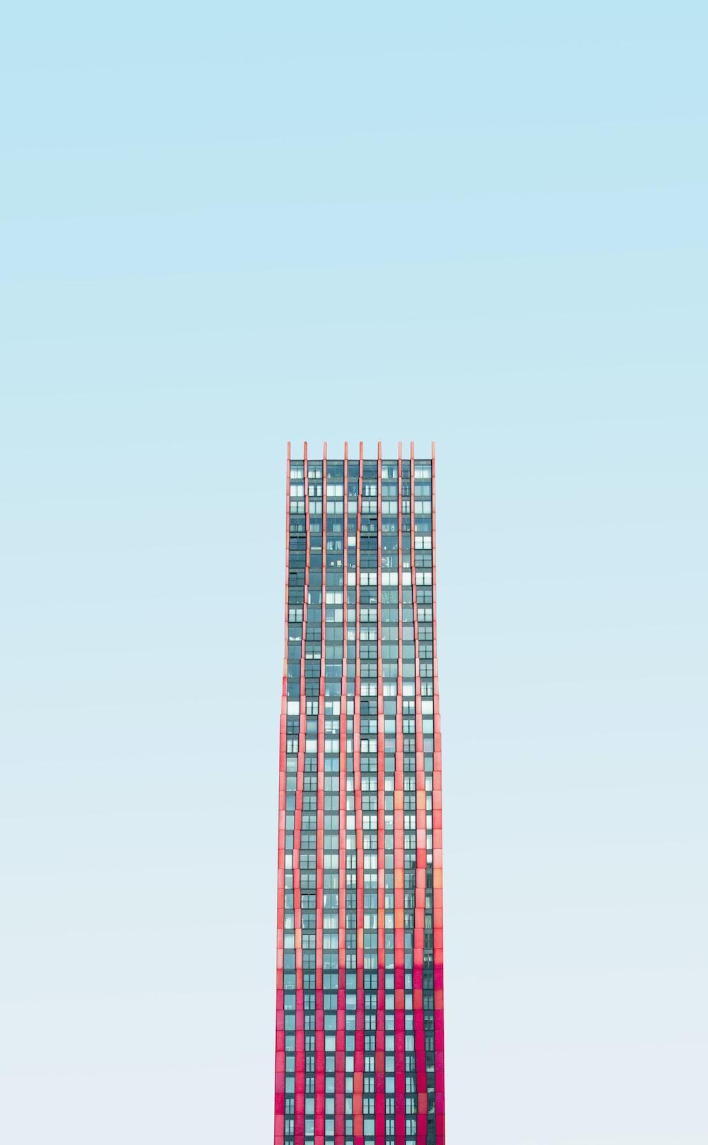 high-rise building under blue skies daytime