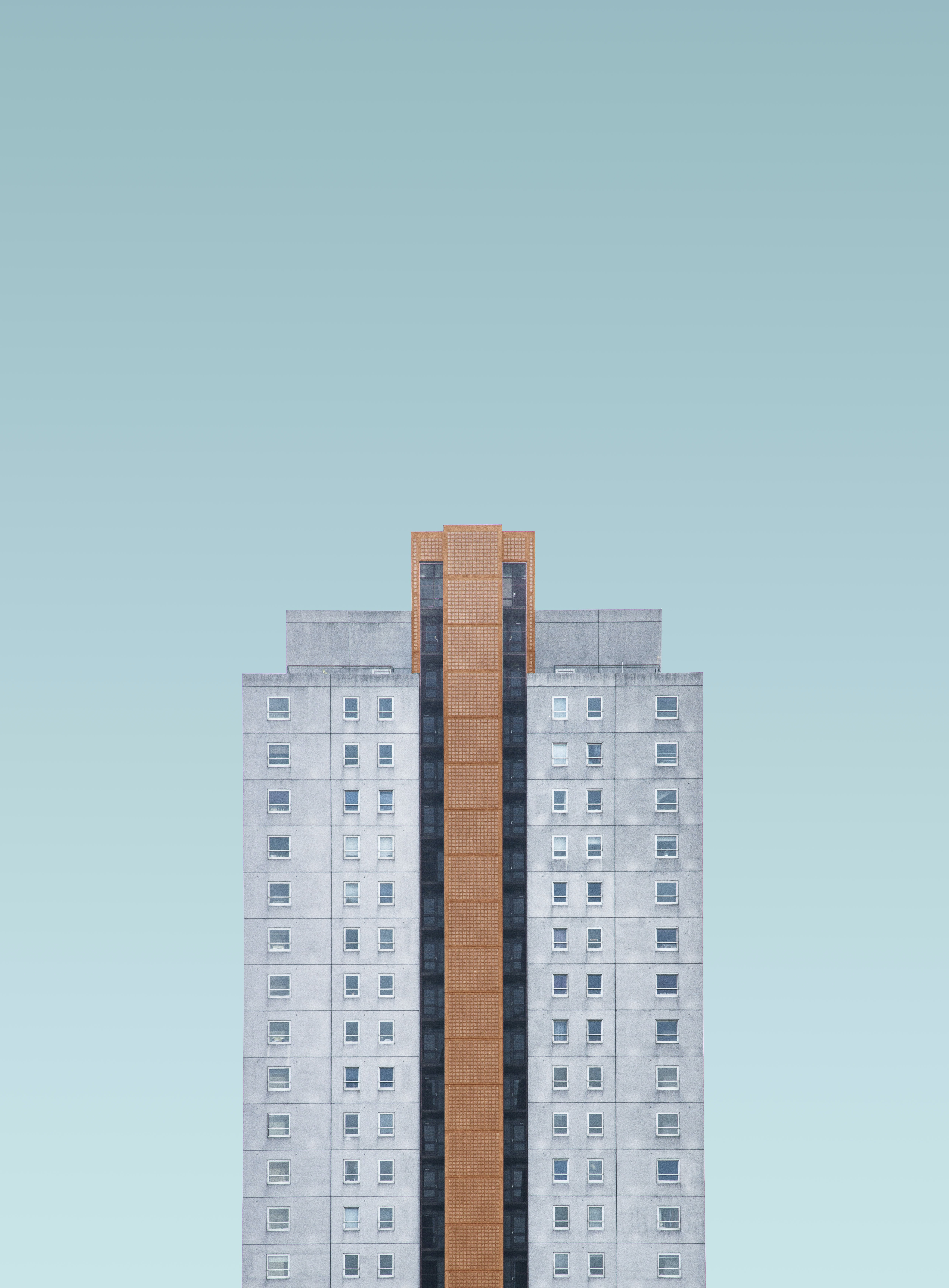 gray and brown high rise building