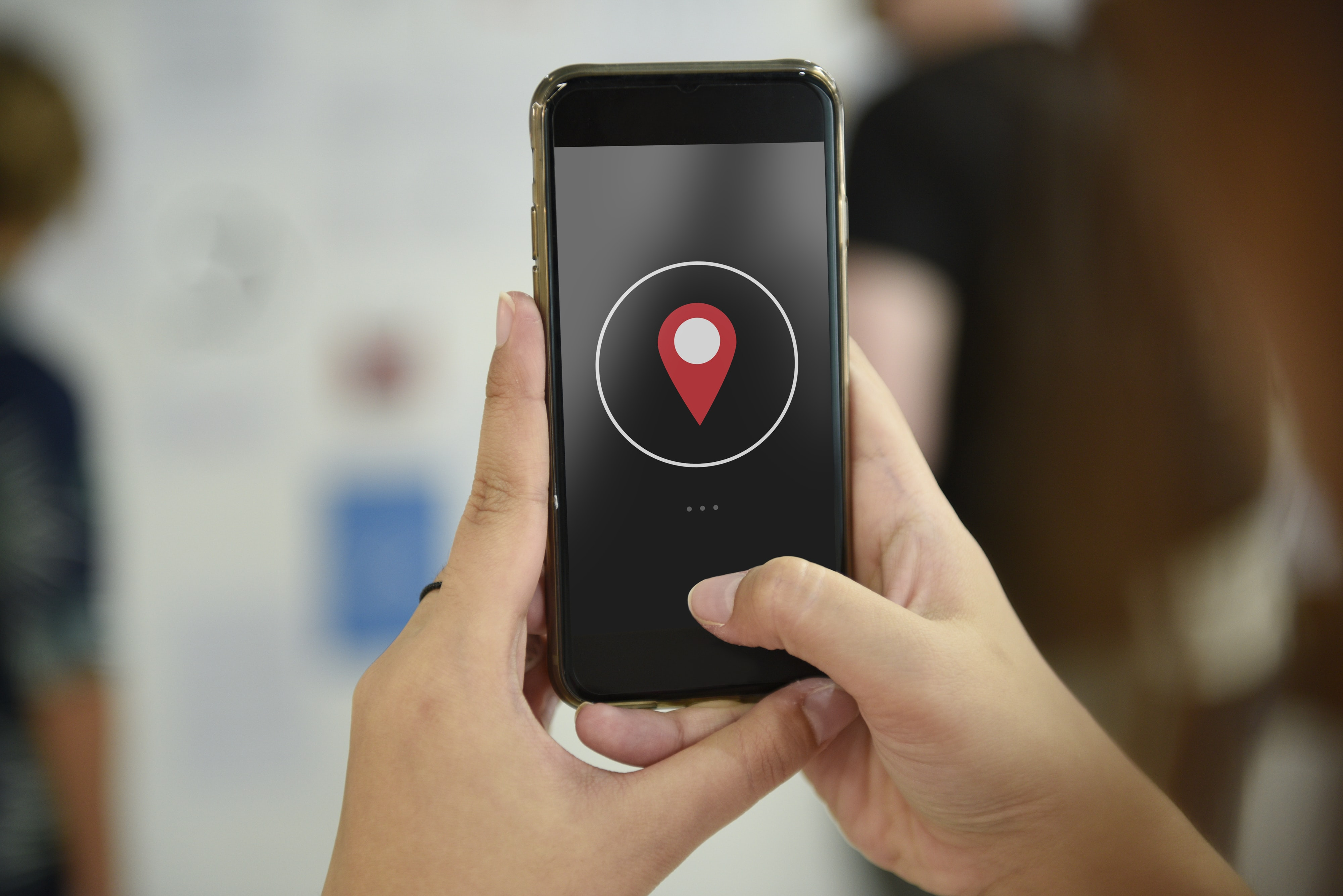 person holding iPhone displaying location