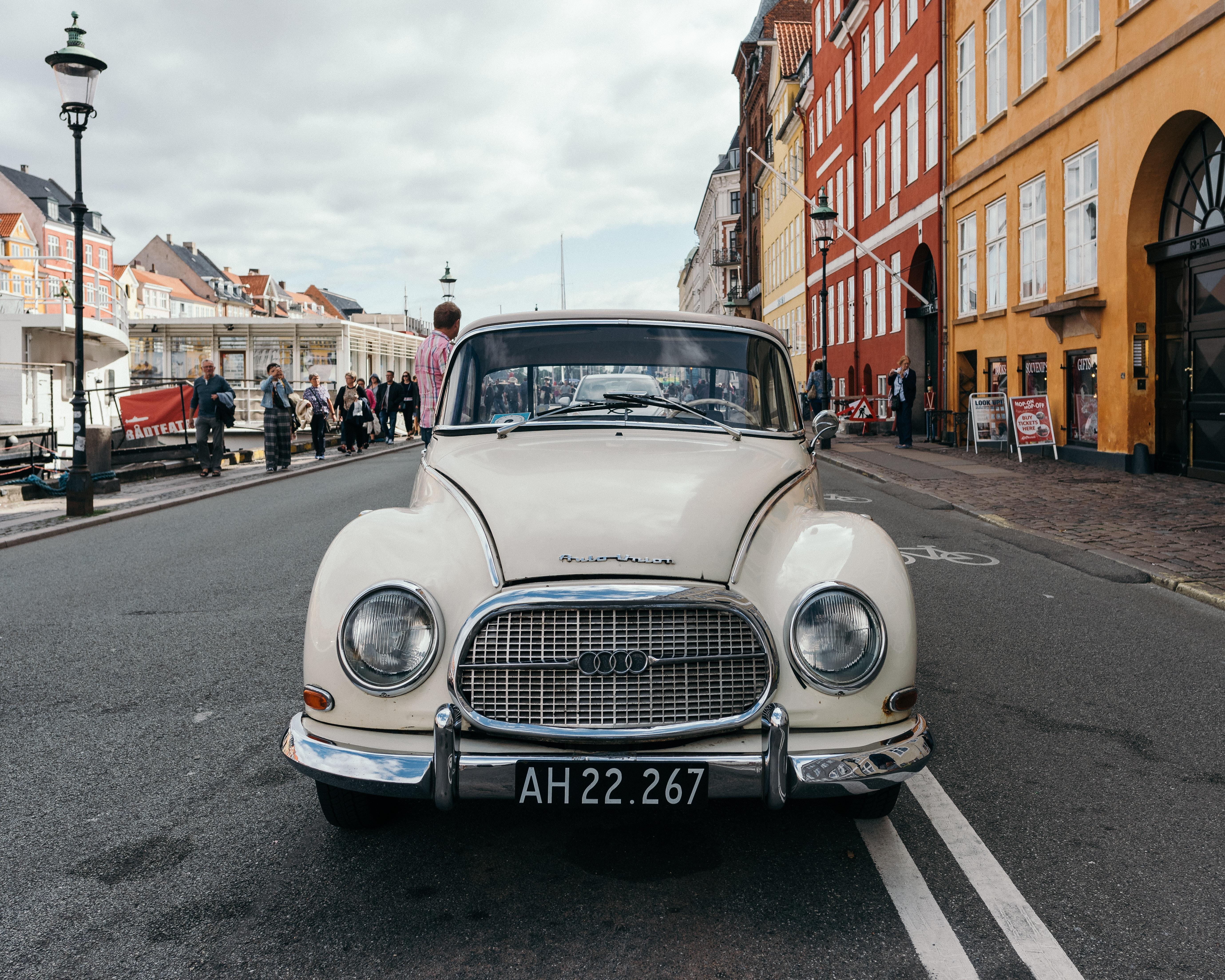 classic white Audi vehicle on asphalt road
