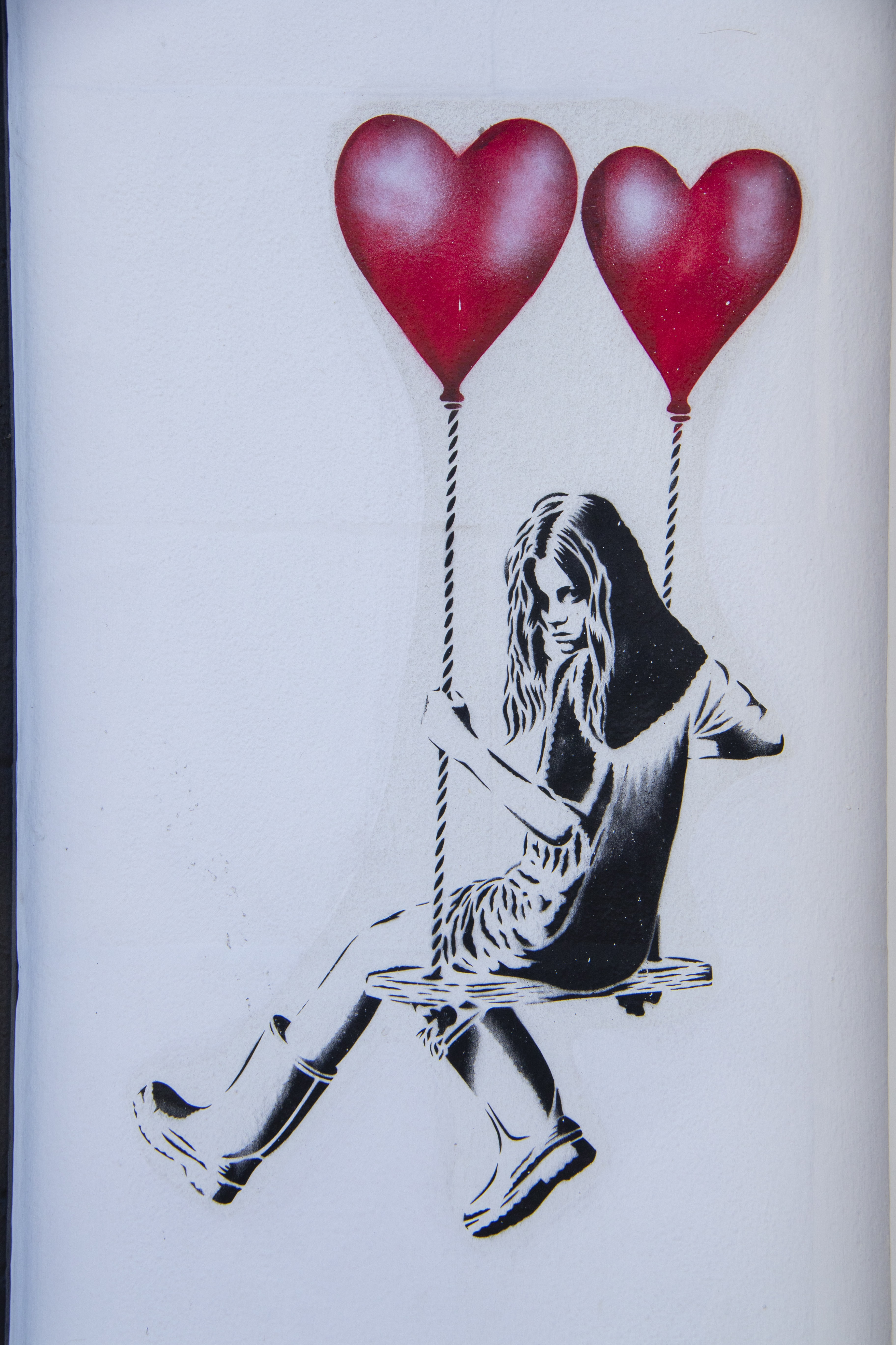 woman swinging on two red hearts sketch
