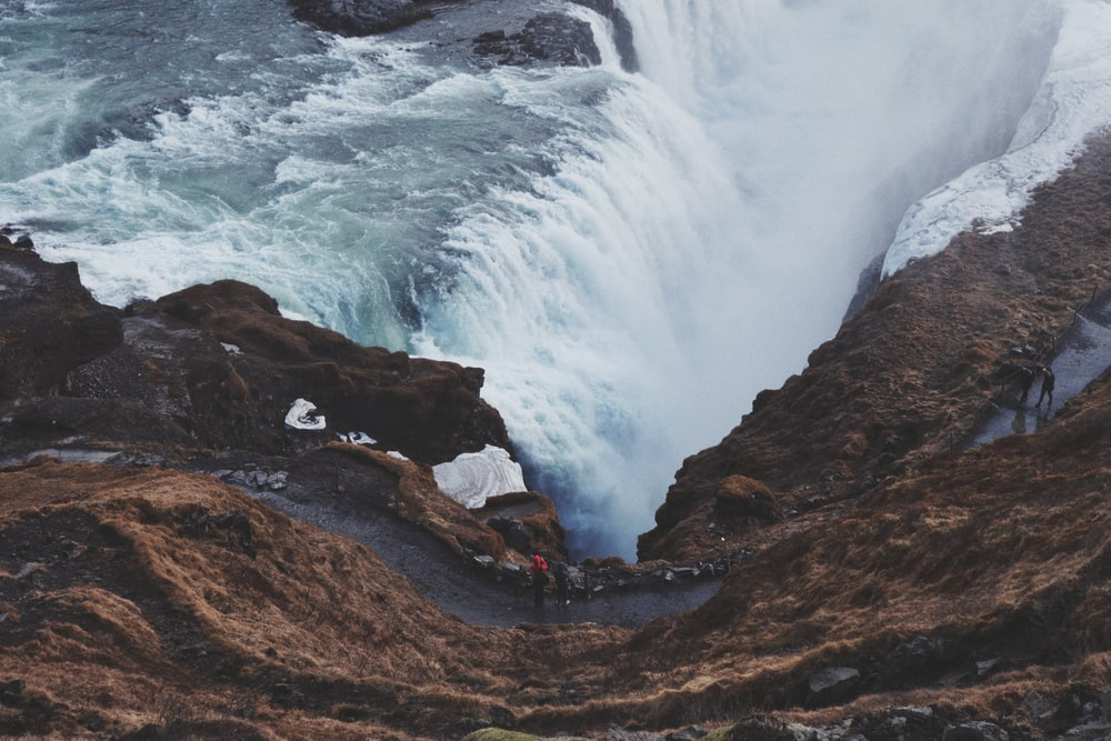 aerial photography of flowing waterfall