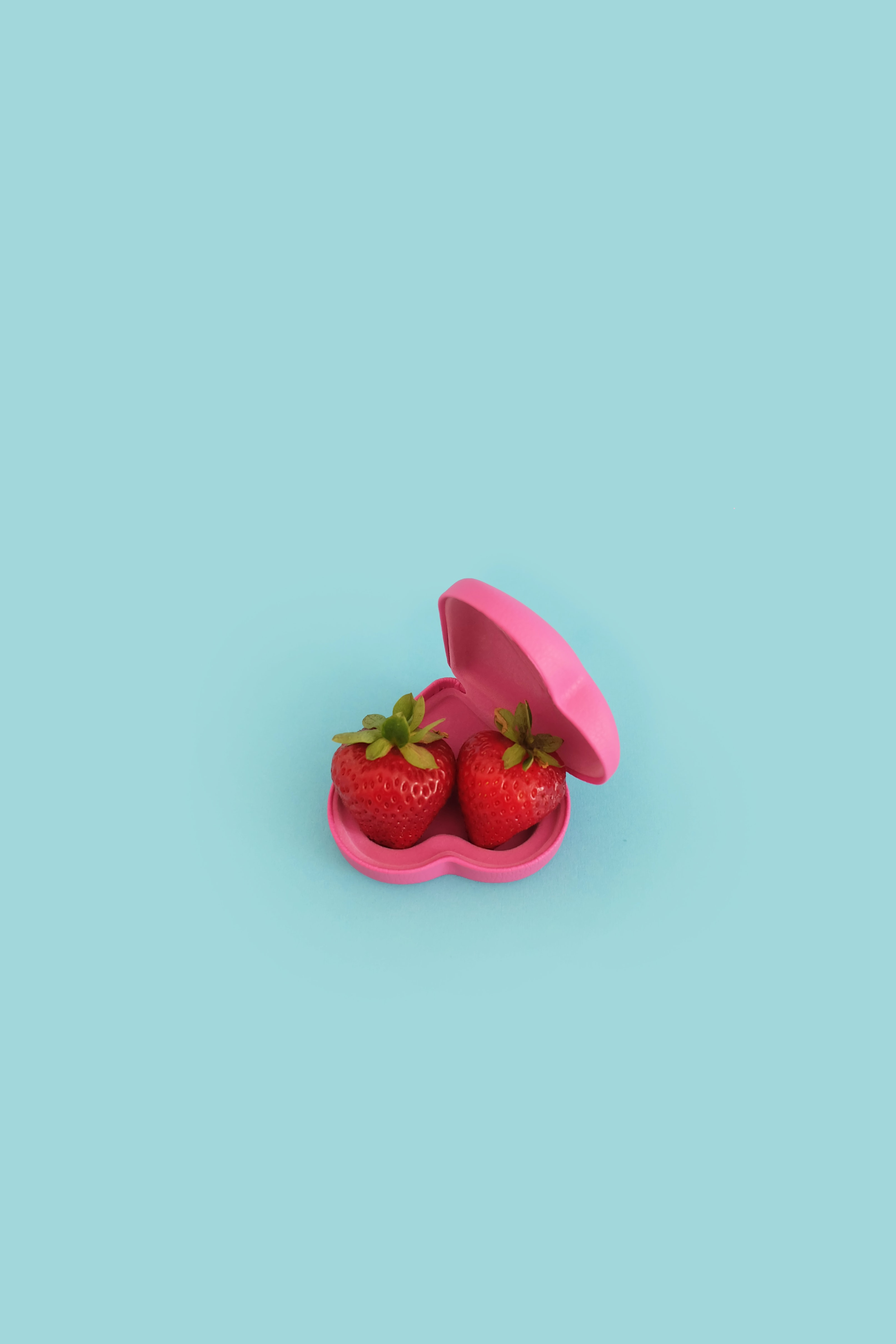 two strawberries on pink case
