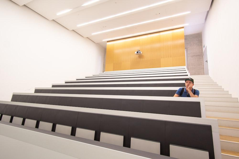man sitting inside auditorium