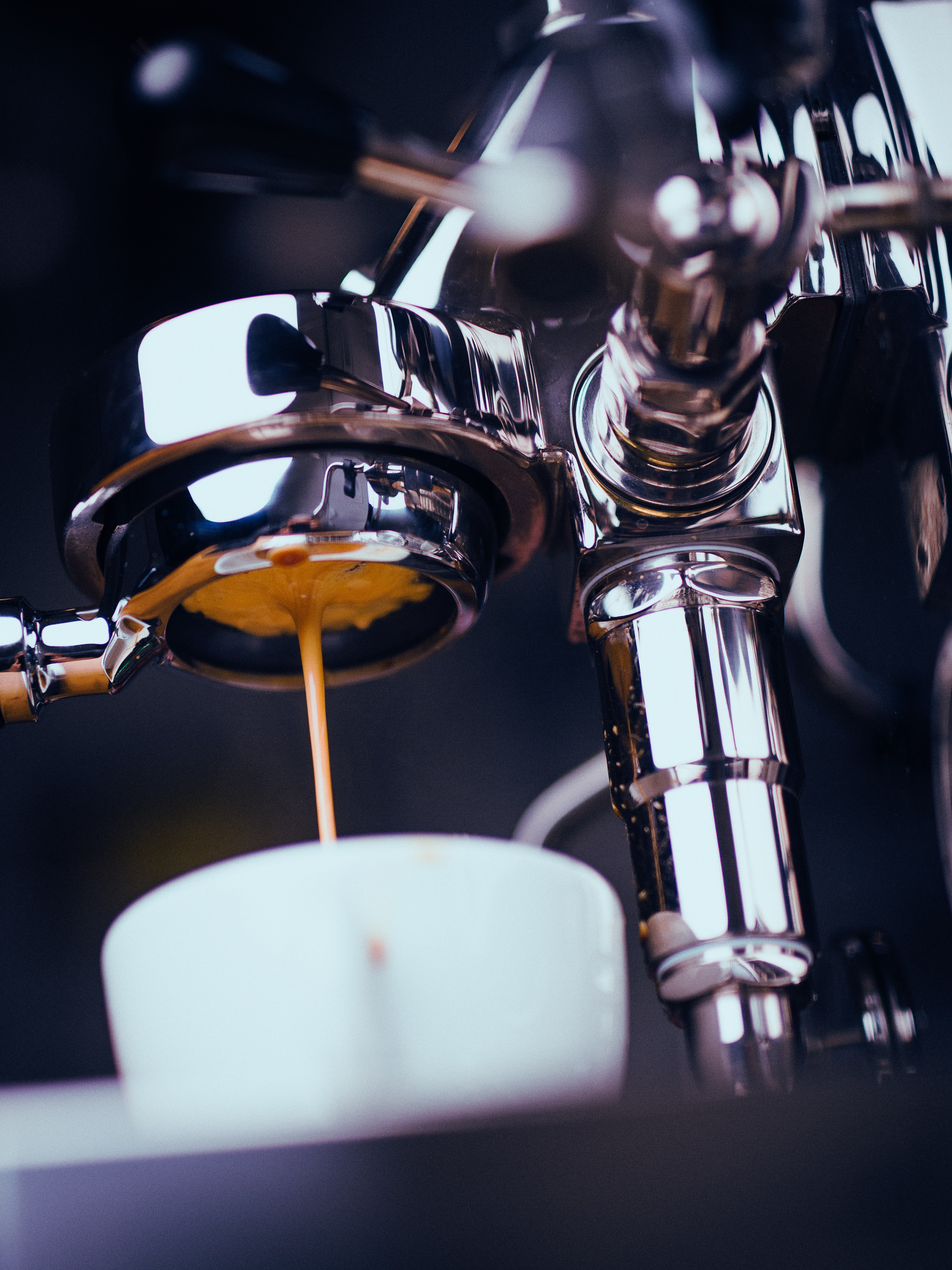 stainless steel espresso machine pouring on cup
