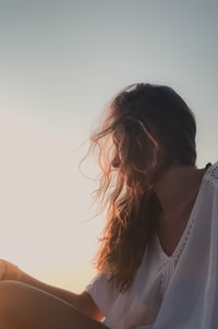women's wearing white V-neck shirt
