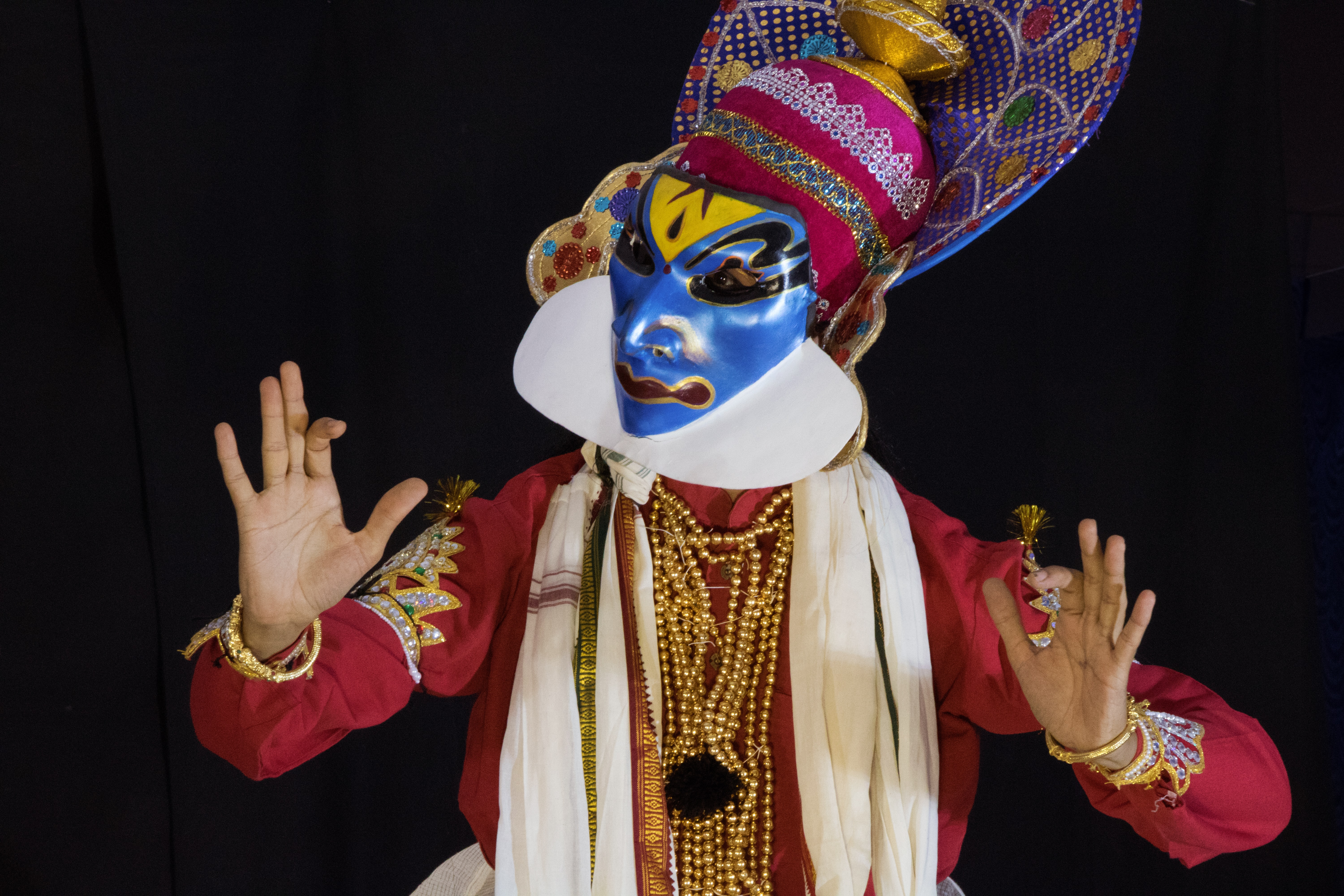 person wearing blue, white, and yellow mask