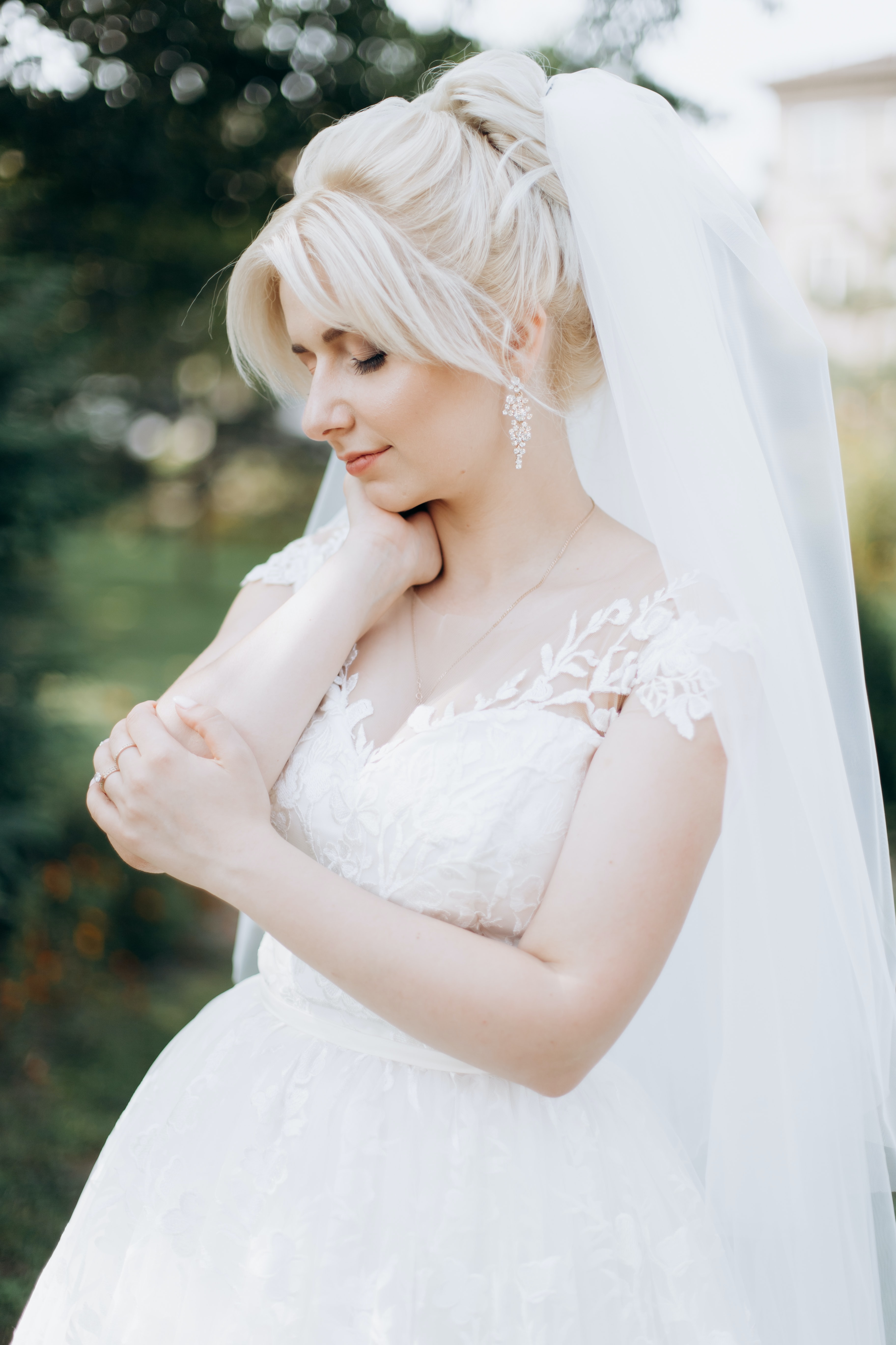 woman in white wedding dress standing at daytime