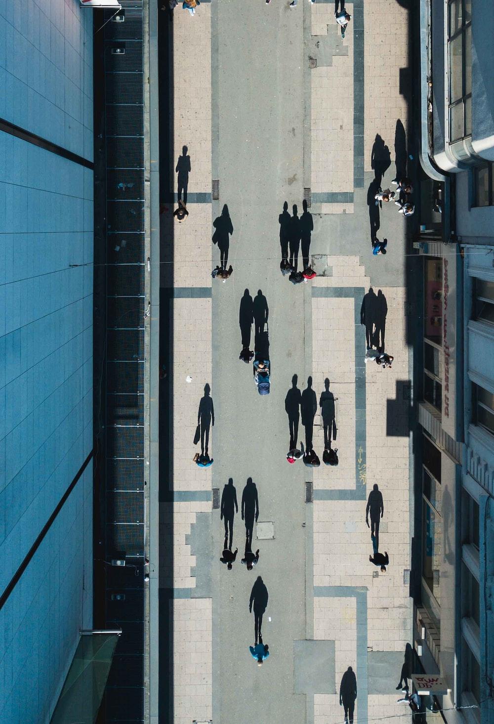 people walking on street between buildings