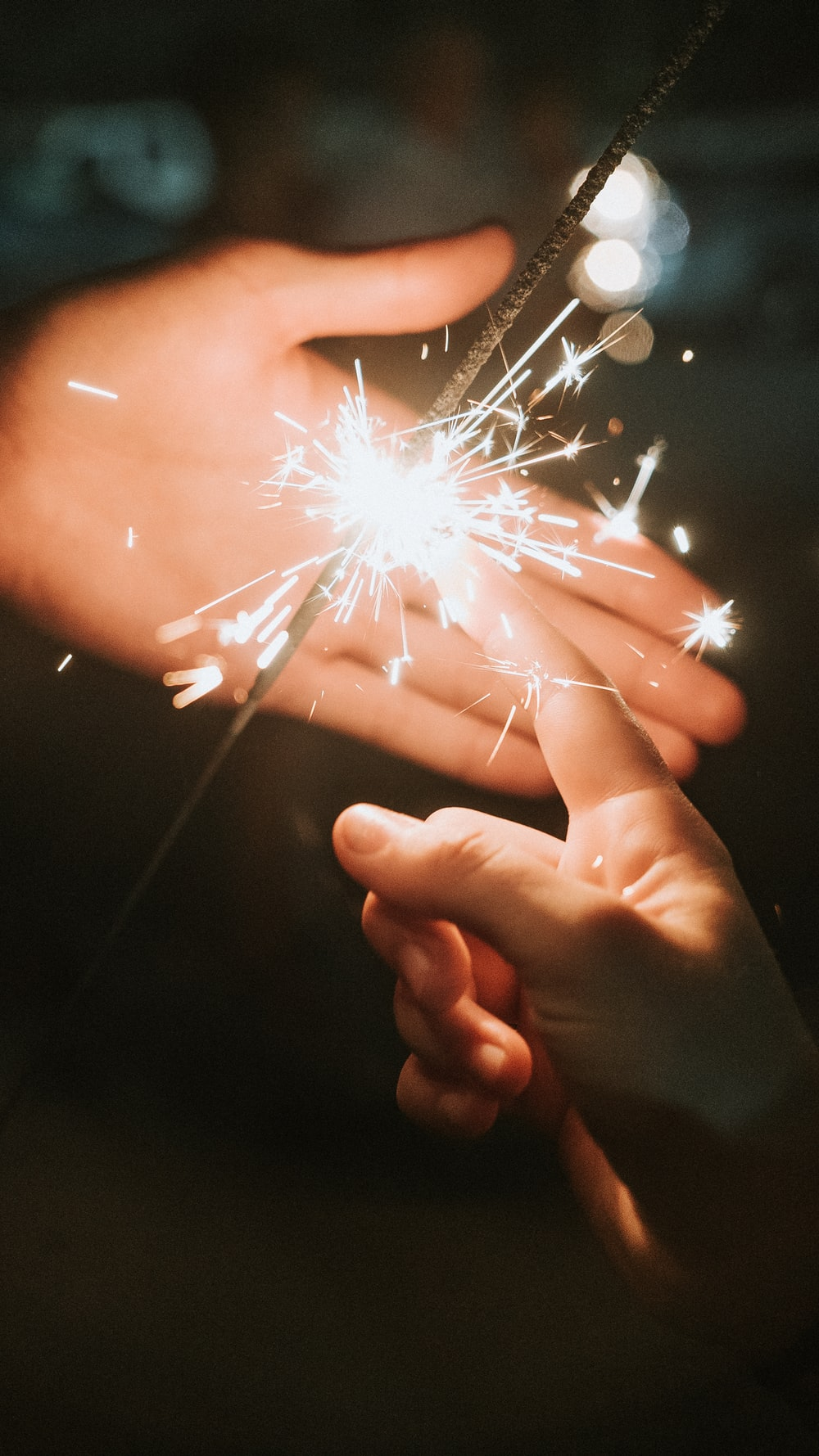 person holding fire cracker