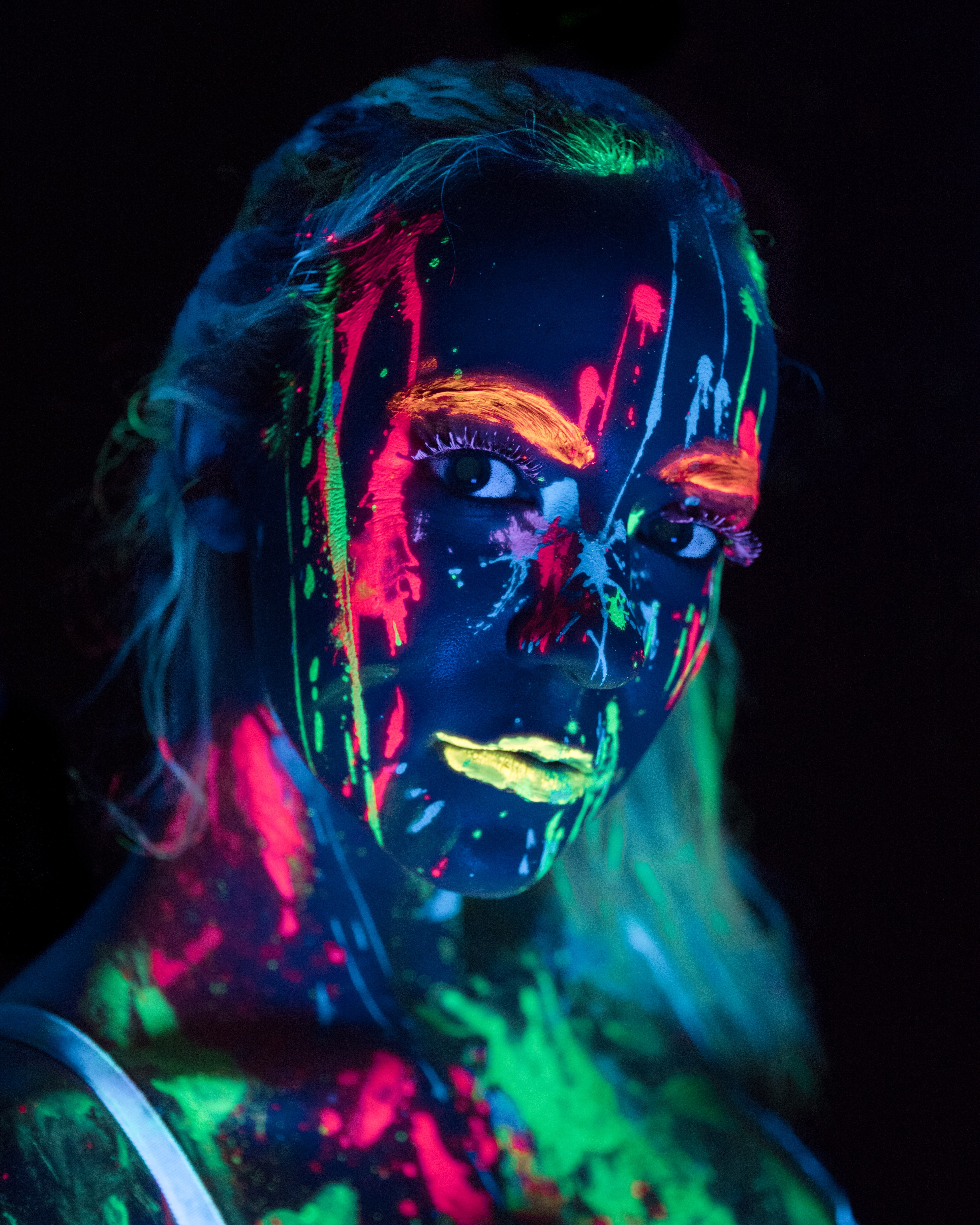woman with glow in the dark body paint