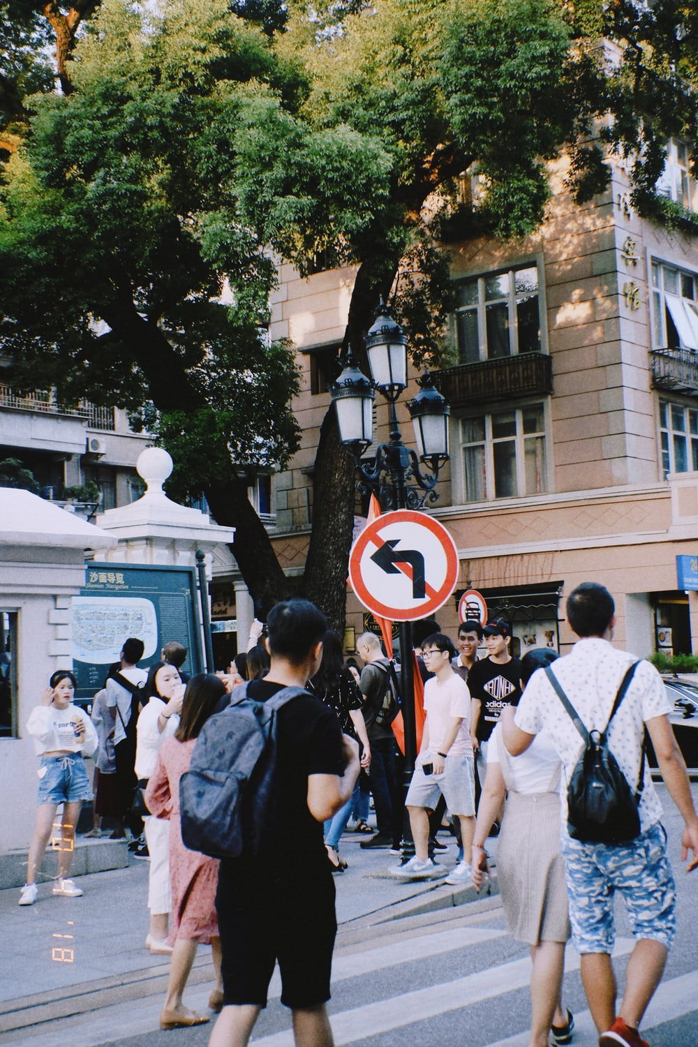 urban photo of a street with crowd