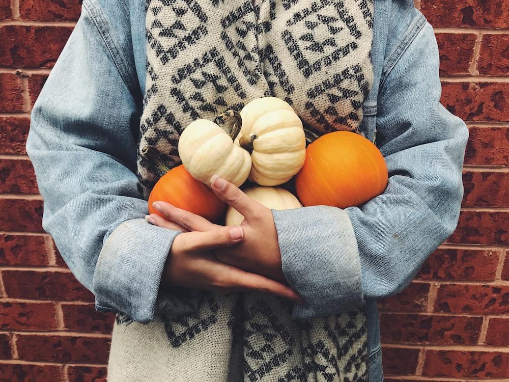 woman carrying pumpkins