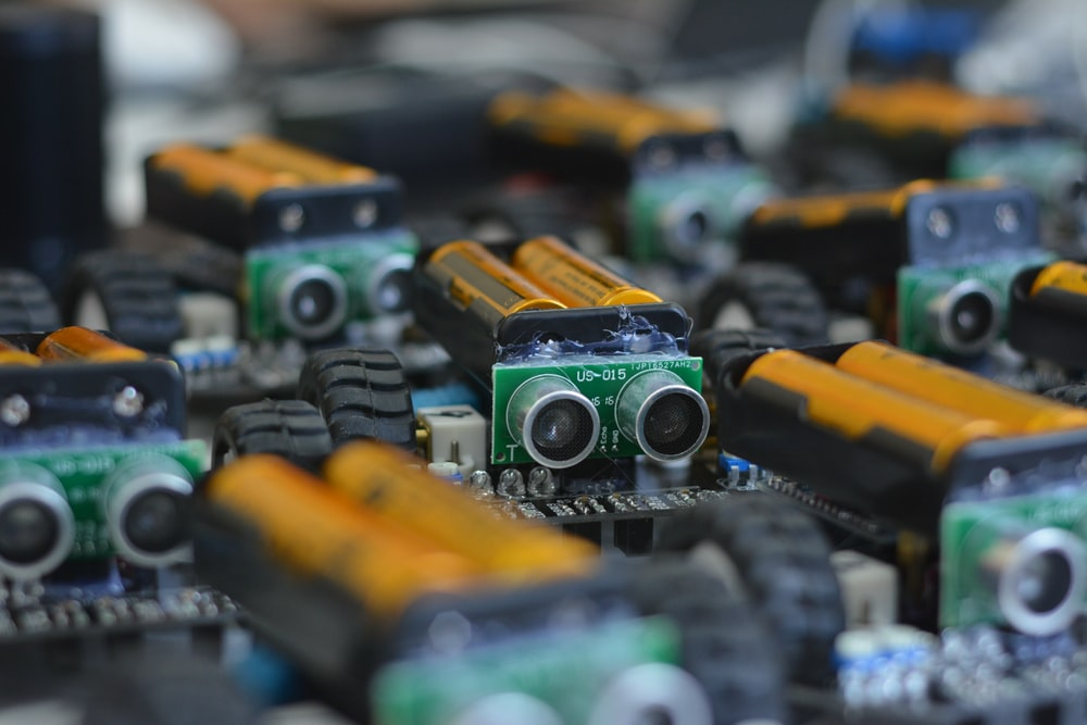 selective photography of yellow batteries