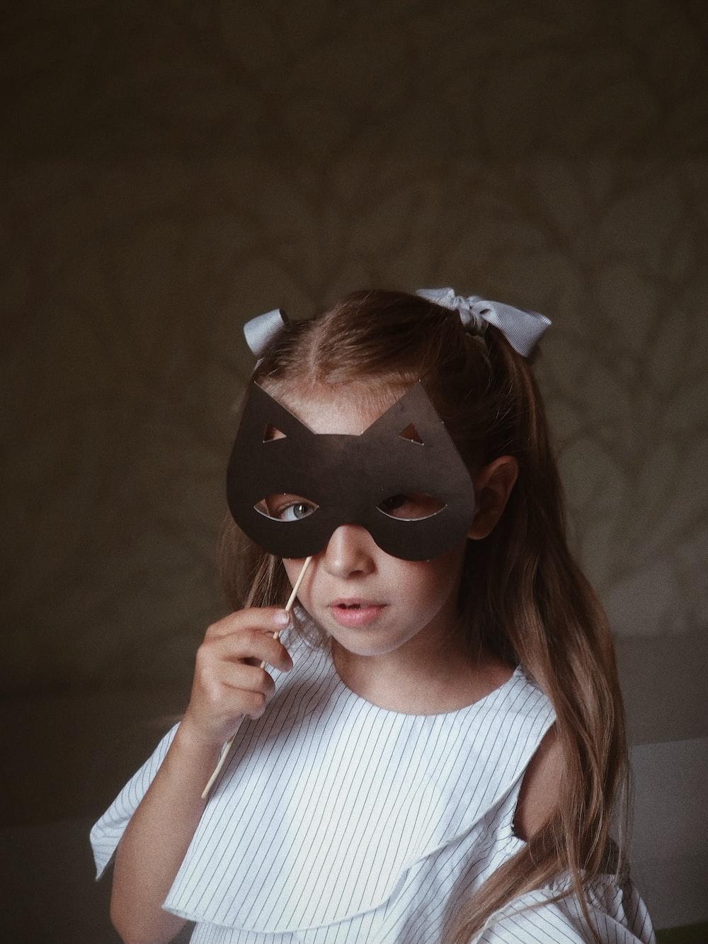 woman holding black eye mask