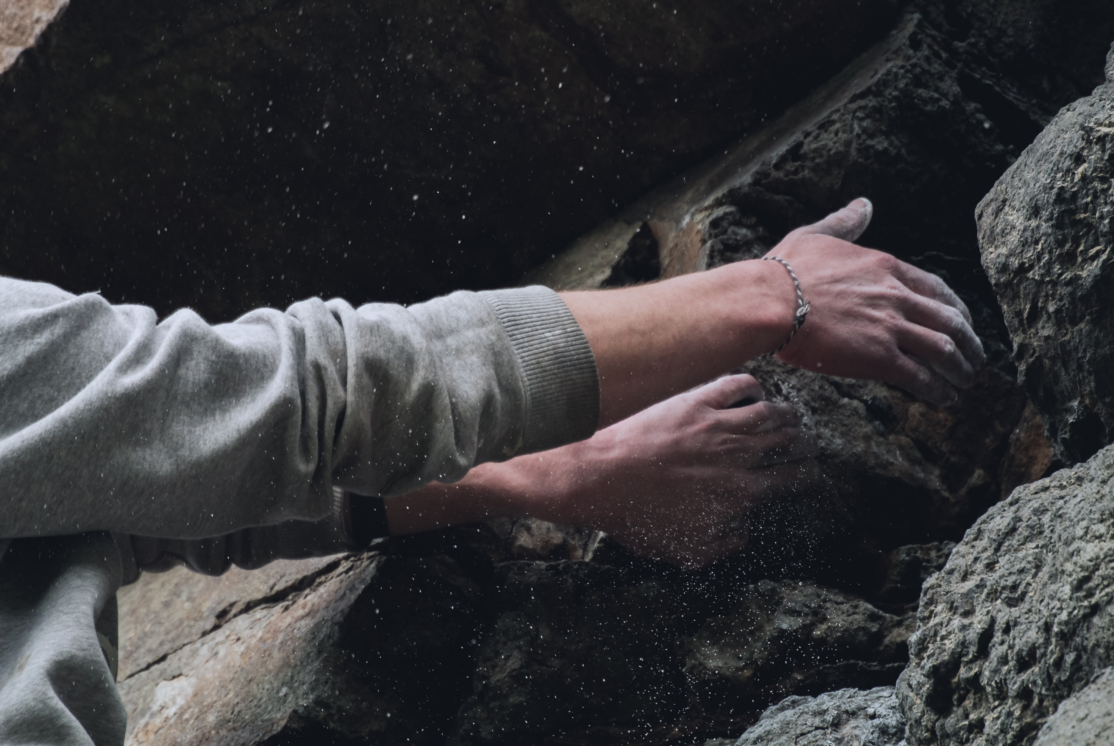 person touching rock