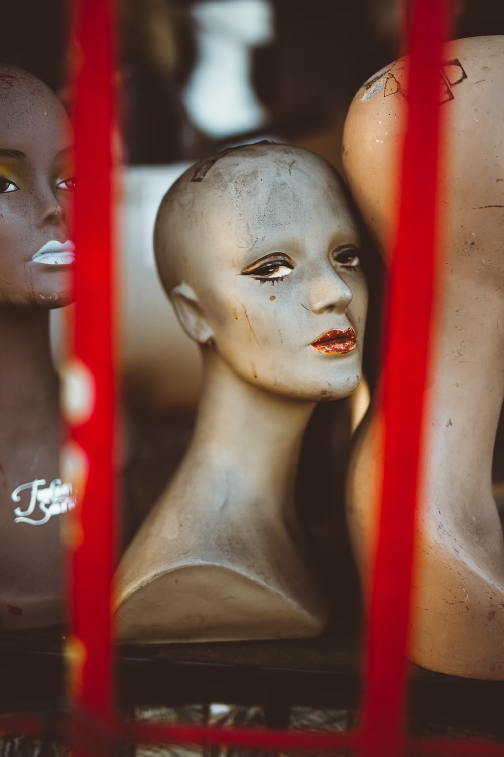 mannequin on brown surface