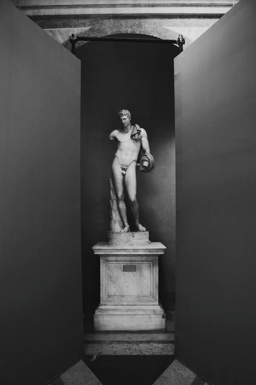 grayscale photo of male statue