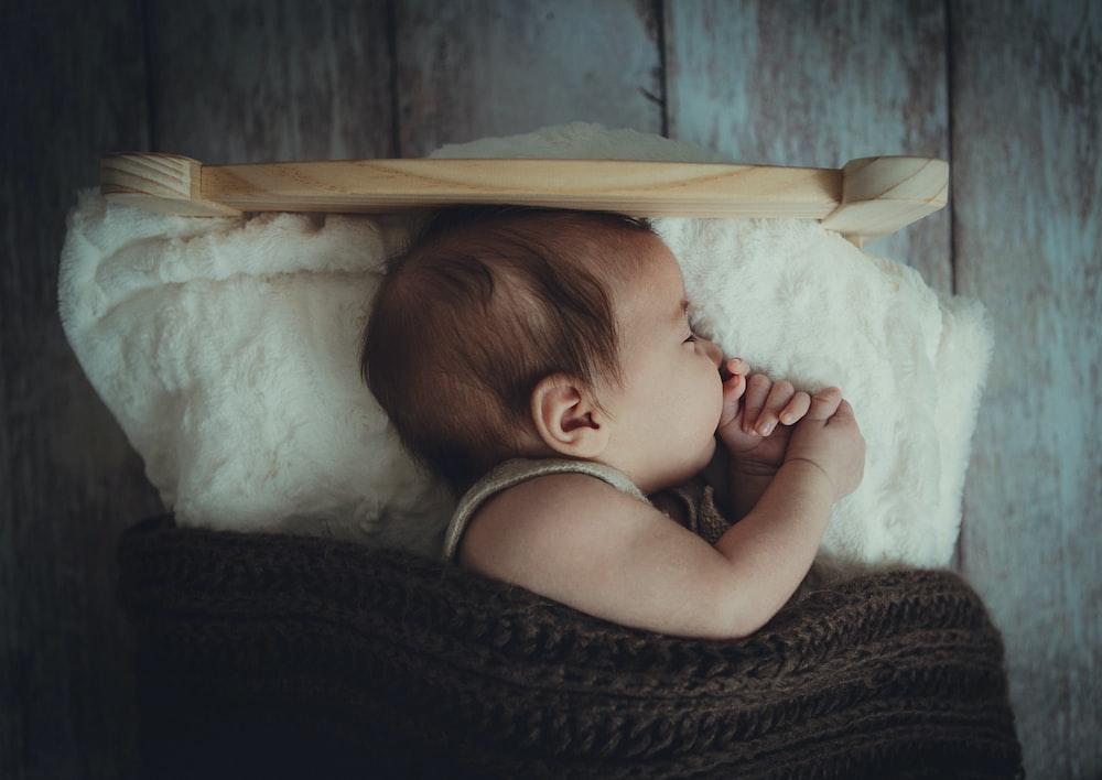 baby's sleeping on white comforter