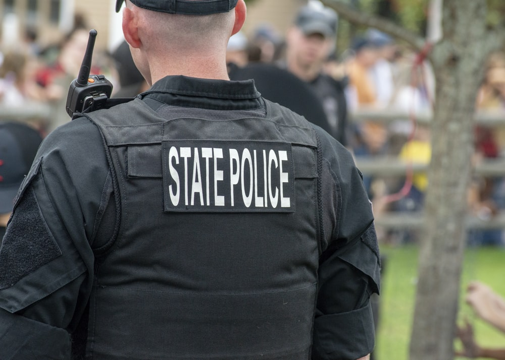 person wearing black State Police vest