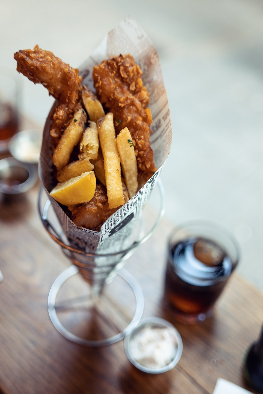 food in glass beside mug