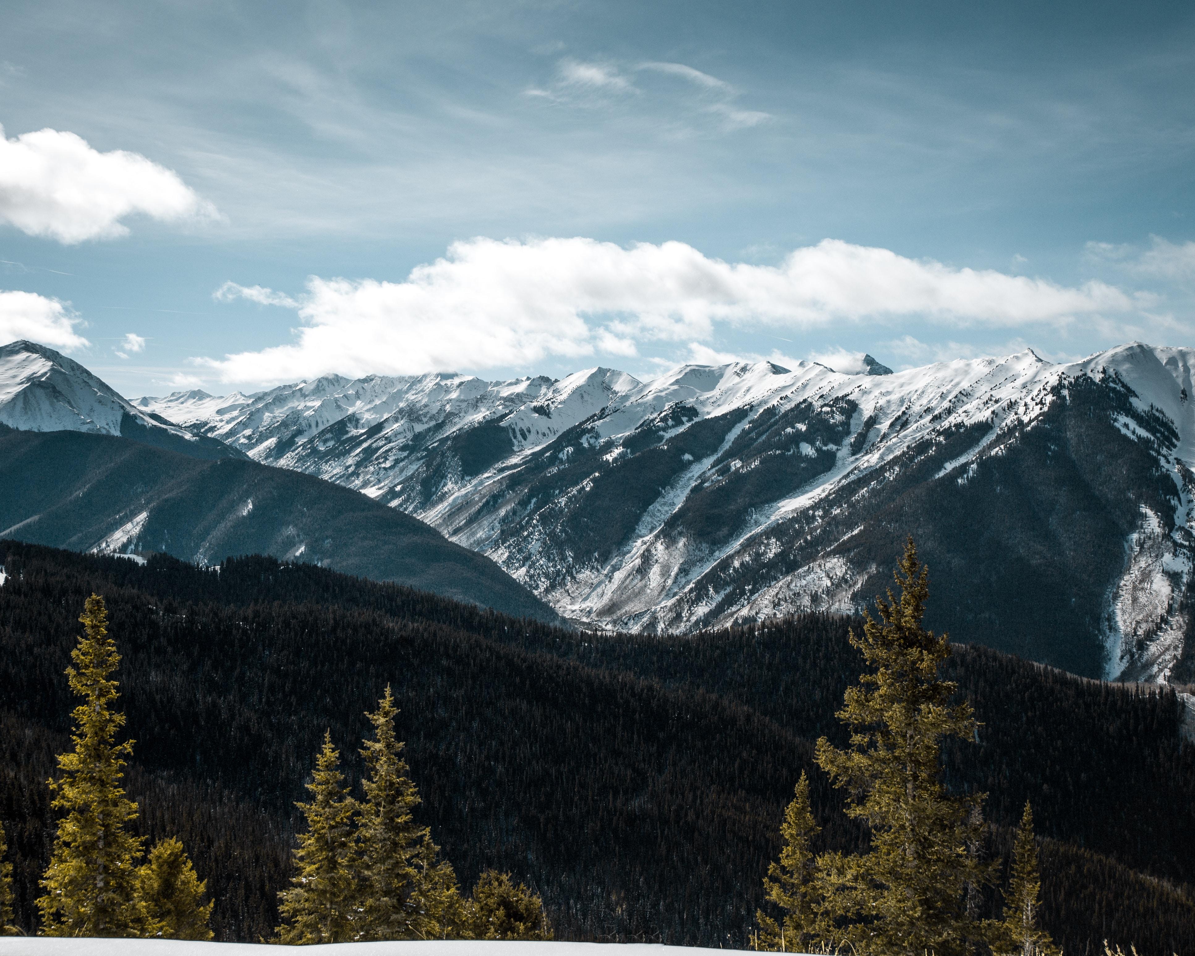 snow covered mountain range during daytime