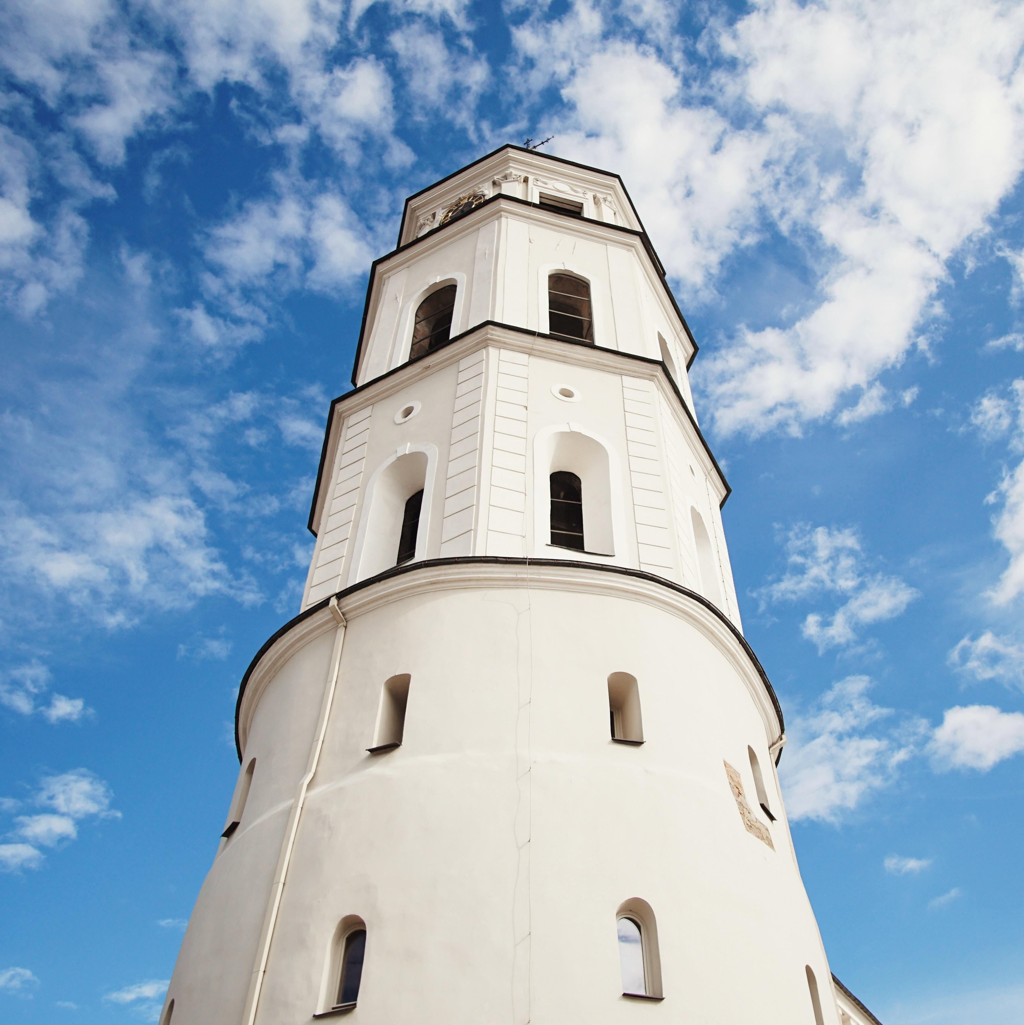white lighthouse under blue sky