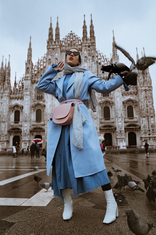 woman near pigeons