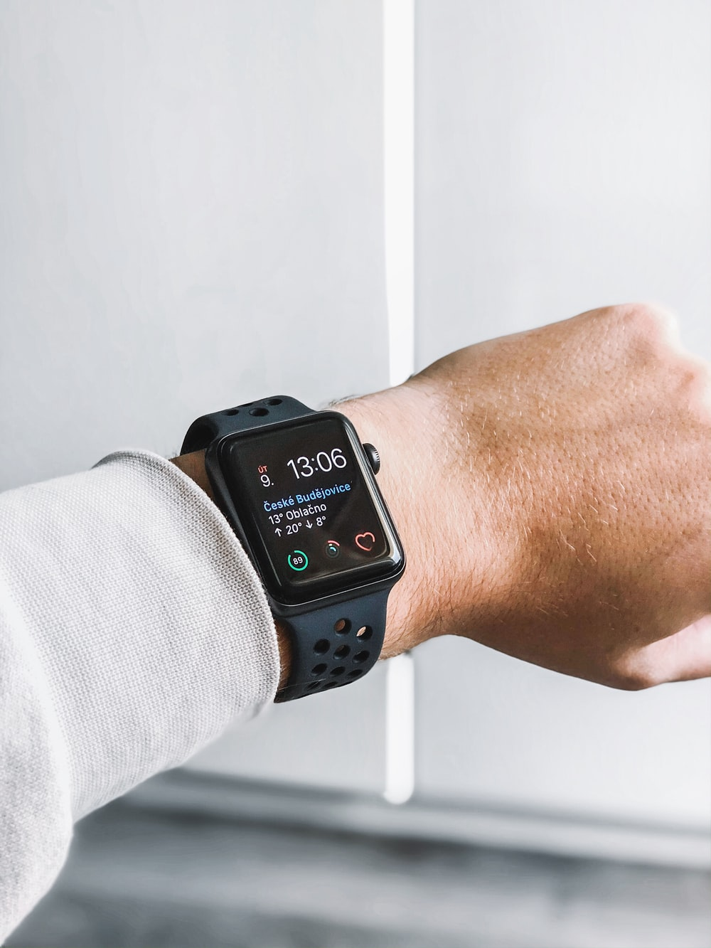 space black stainless steel Apple Watch at 13:05