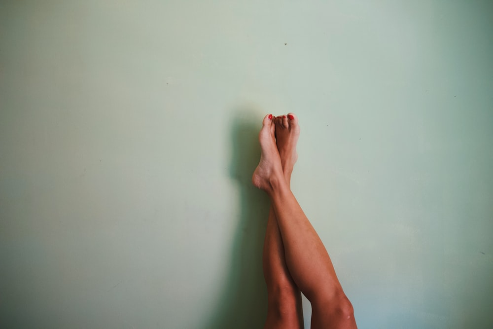 person leg on wall