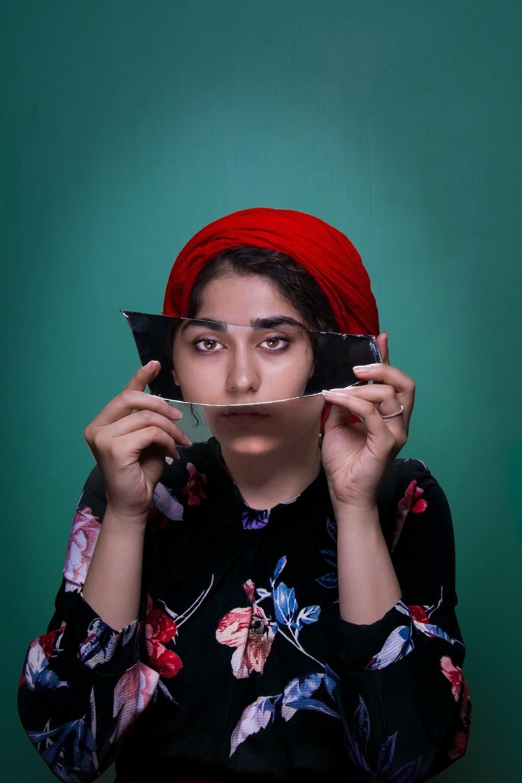 woman holding mirror shard