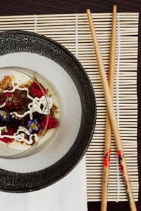 chopsticks beside gray and white plate