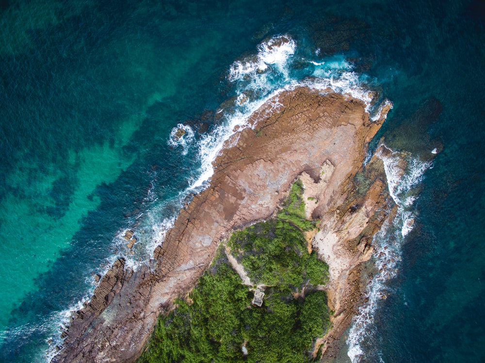 aerial photography of an island with green trees