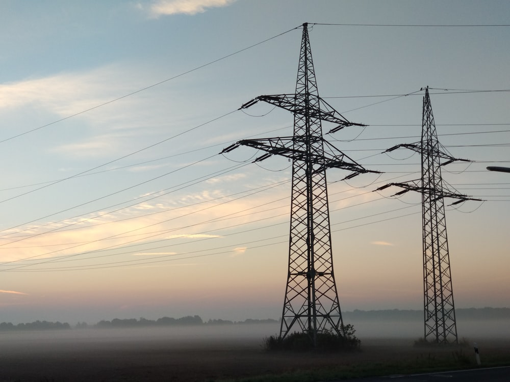two black electric transmission towers