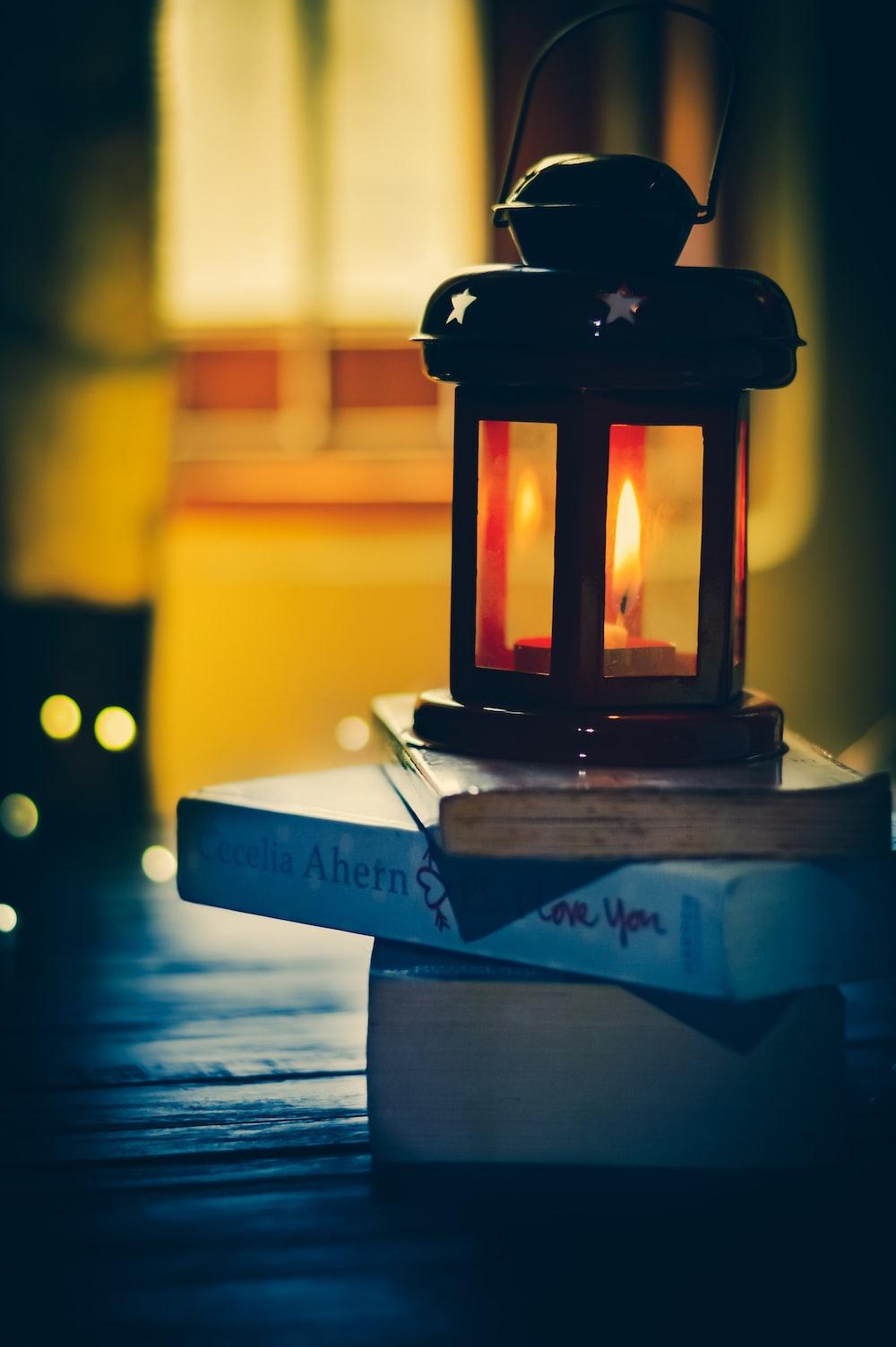 black lamp on three books
