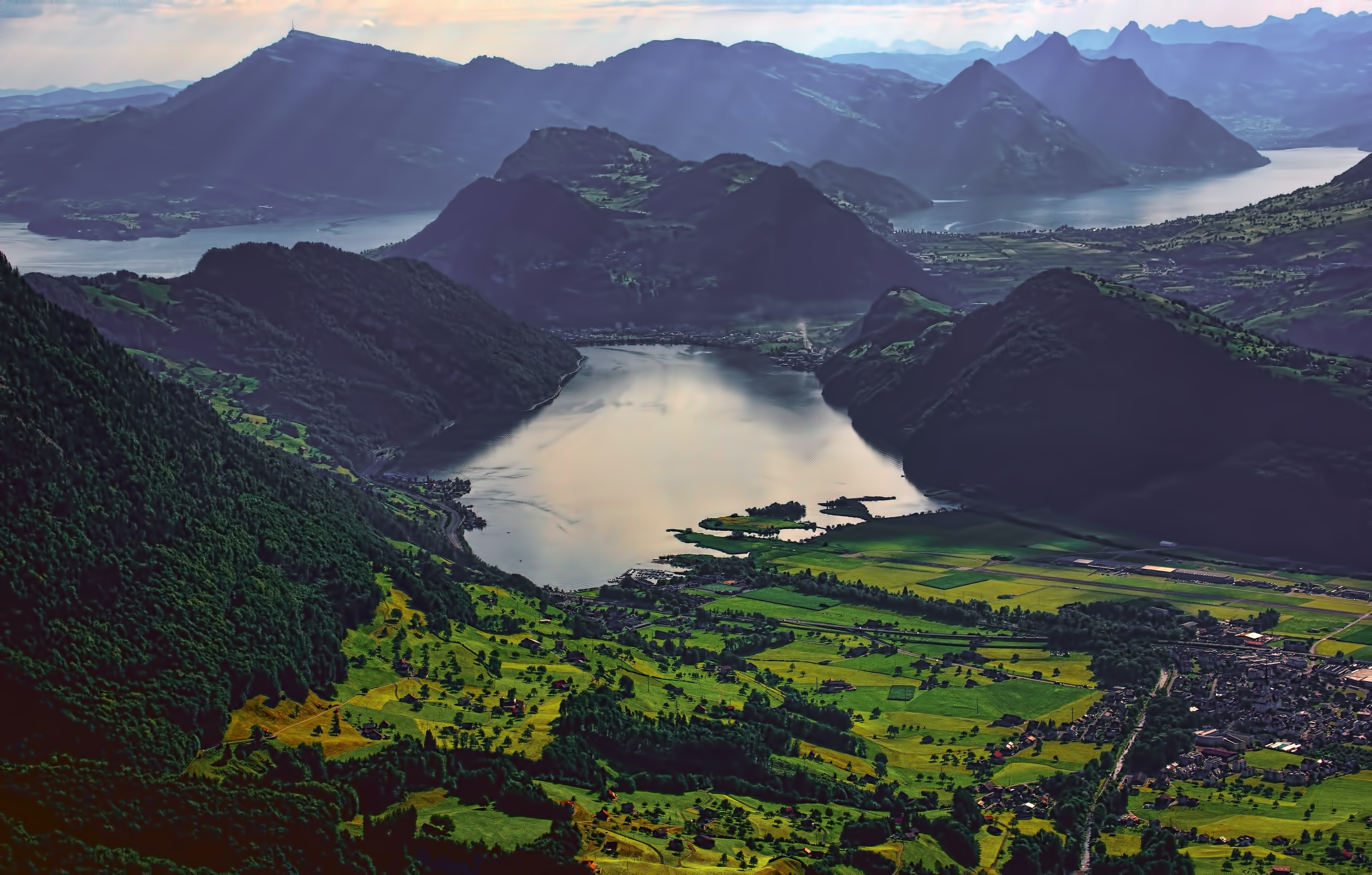 aerial photography of body of water surrounded by mountains