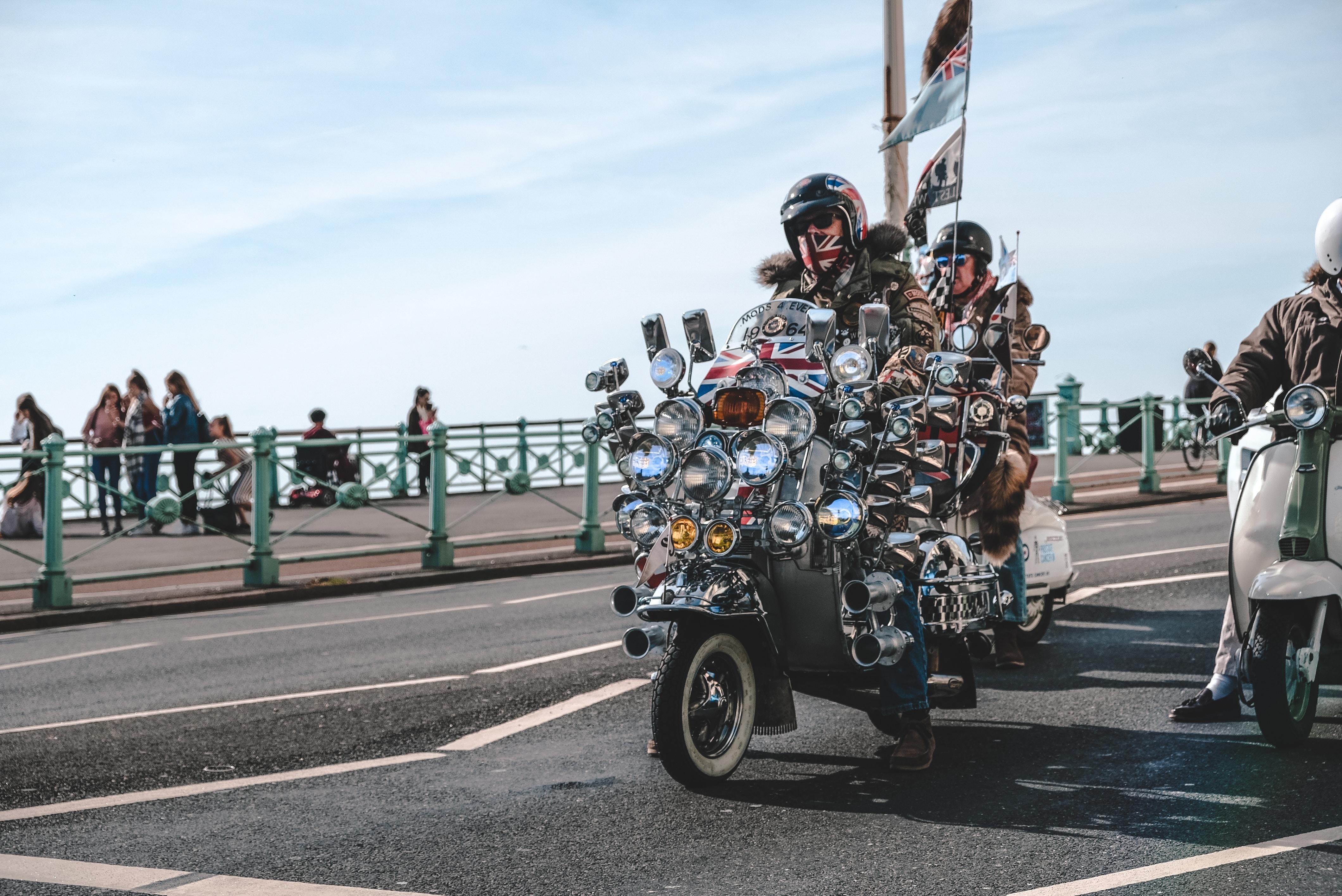 three men riding motorcycles