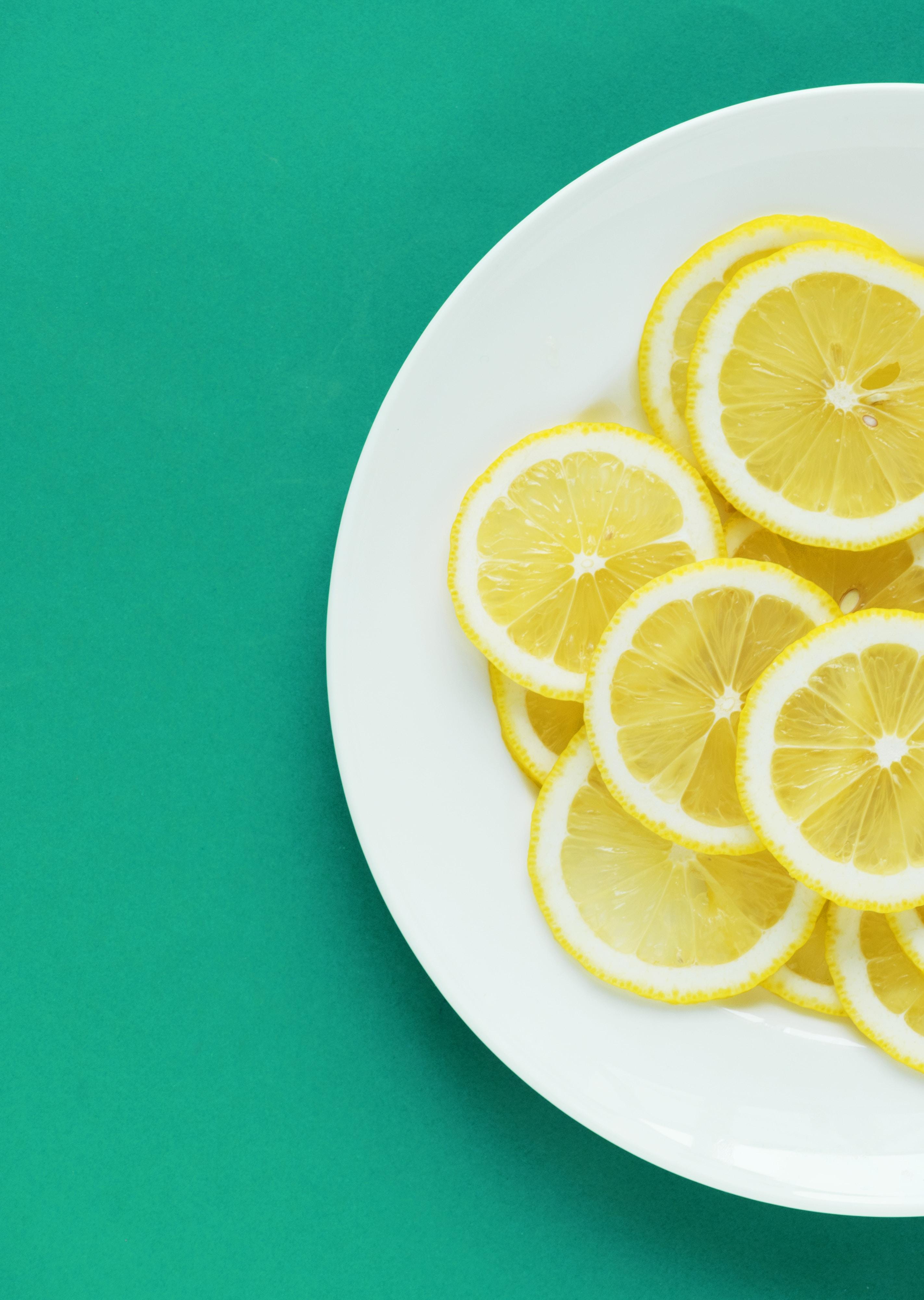sliced lemons on white plate