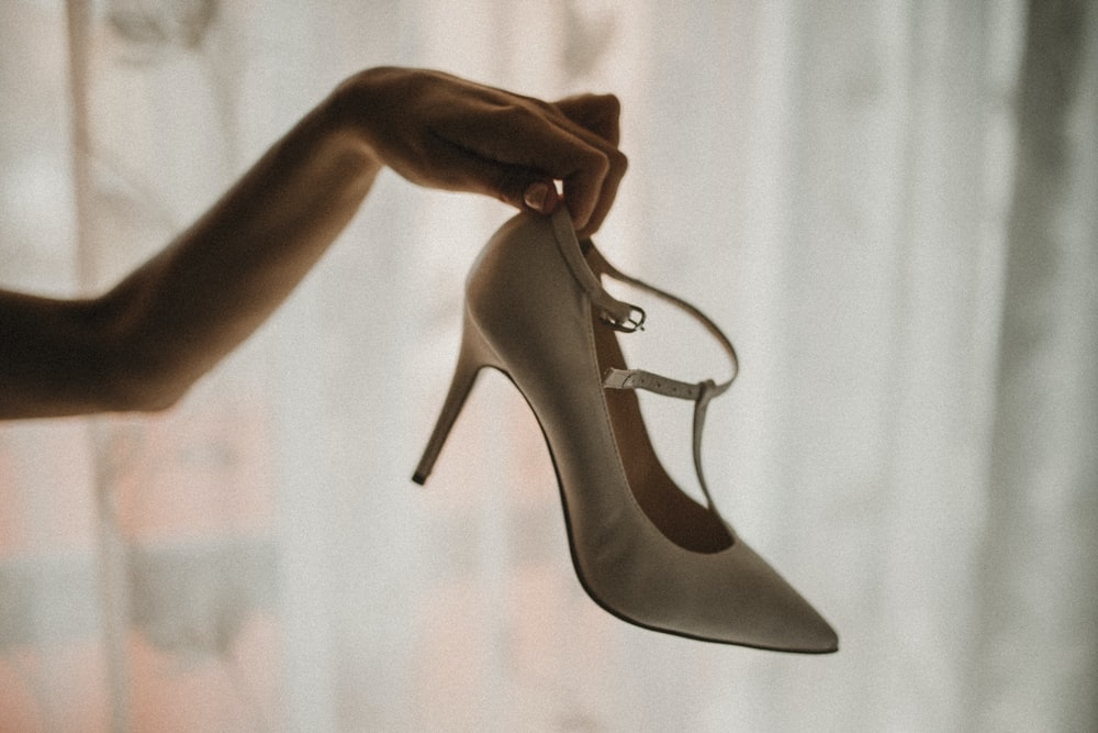 gray leather pointed-toe pumps