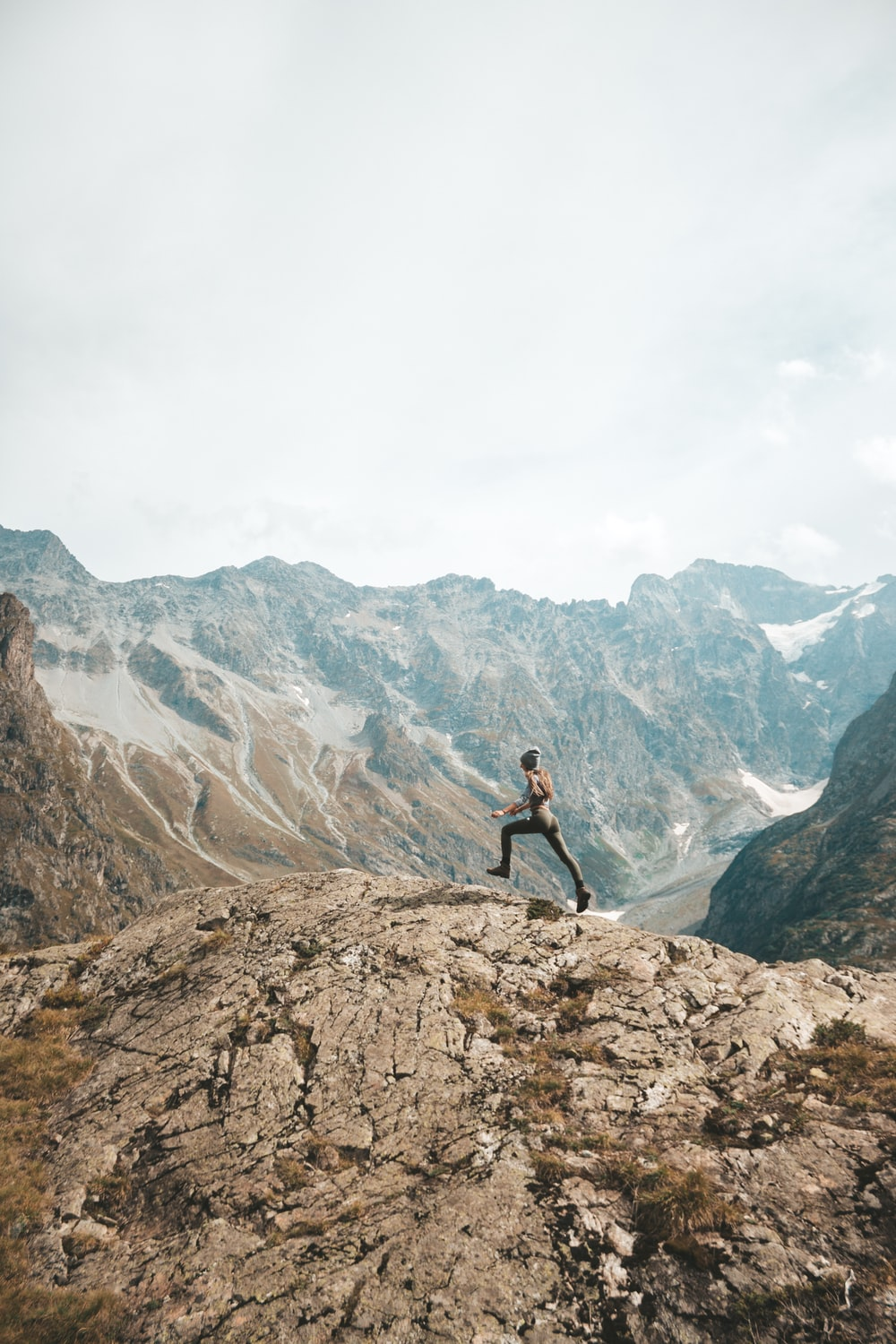 person standing on mountain scenery