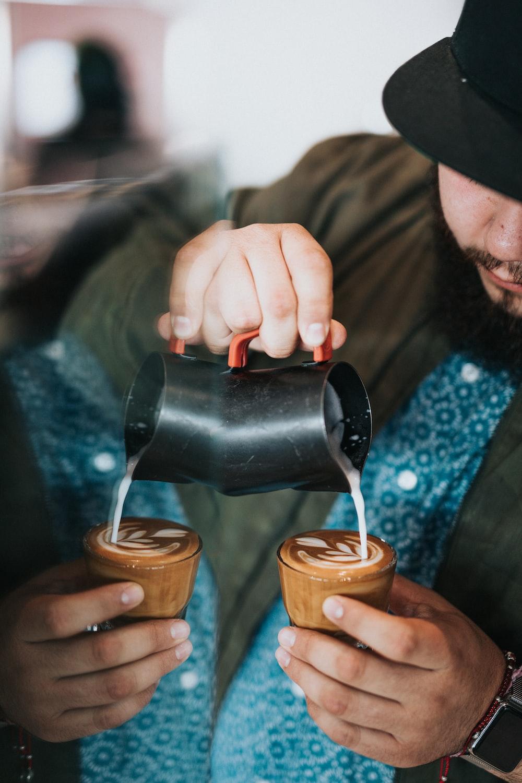 man making cappuccino