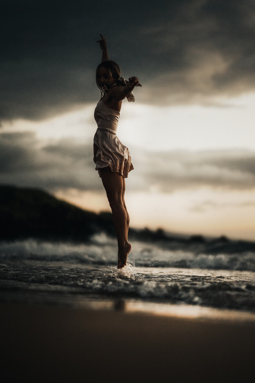 selective focus photography of woman jumps into water