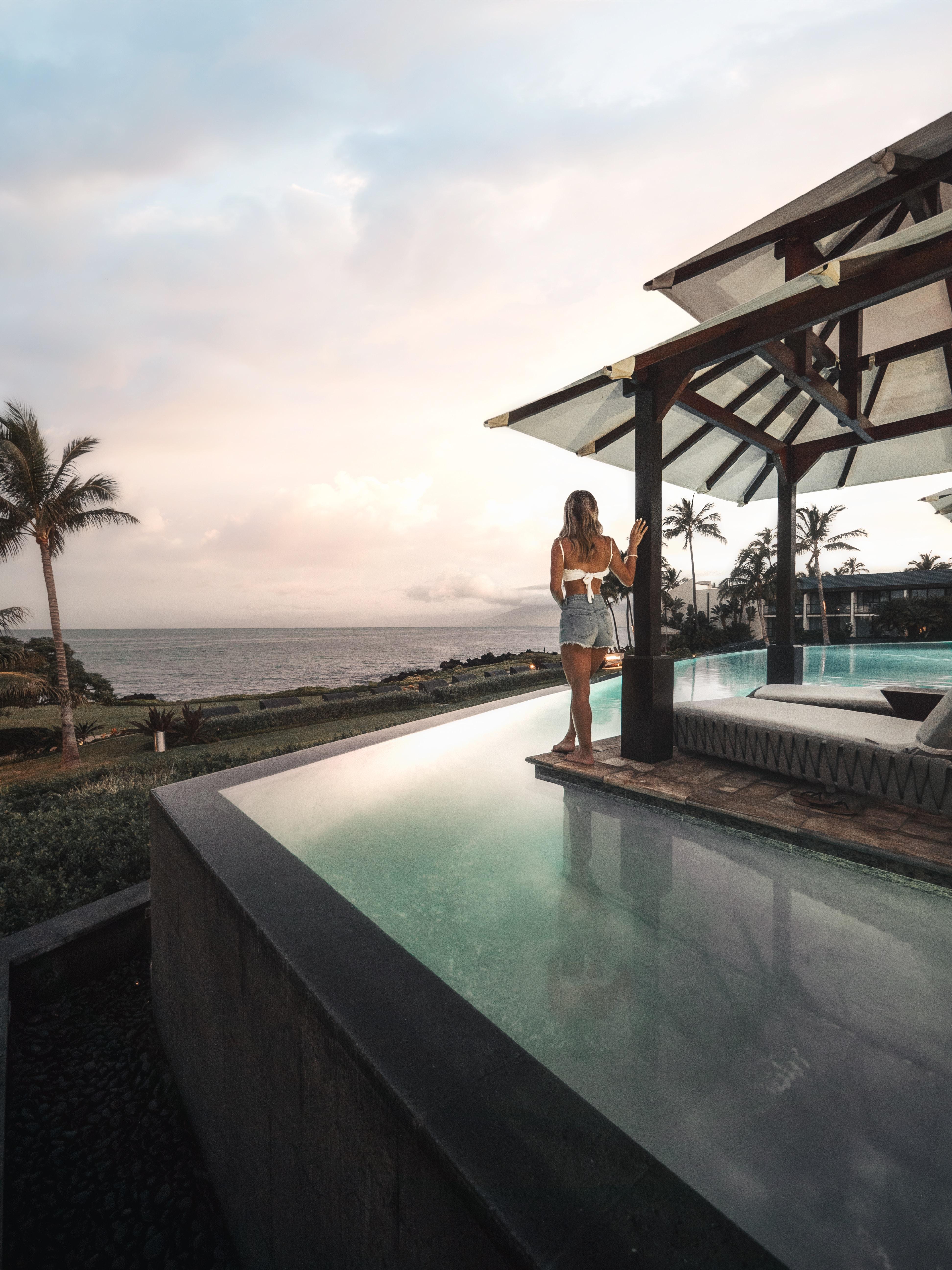 woman standing beside pool