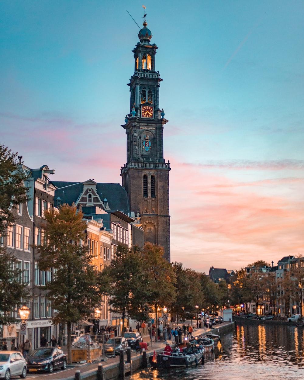 brown clock tower under golden sky