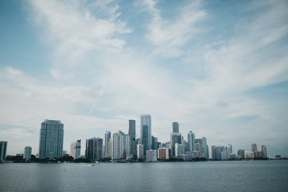 landscape photography of city beside body of water