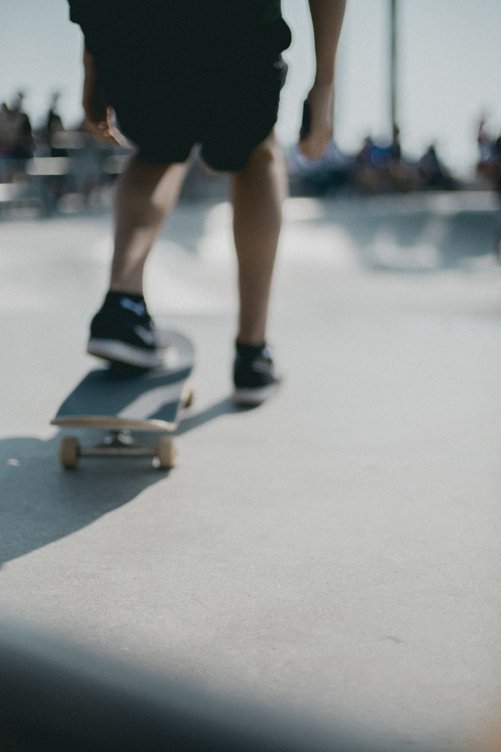 person about to ride skateboard