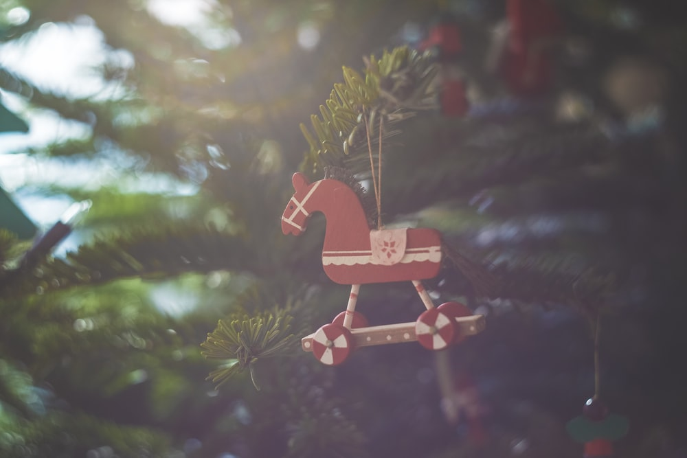 red wooden house miniature in christmas tree